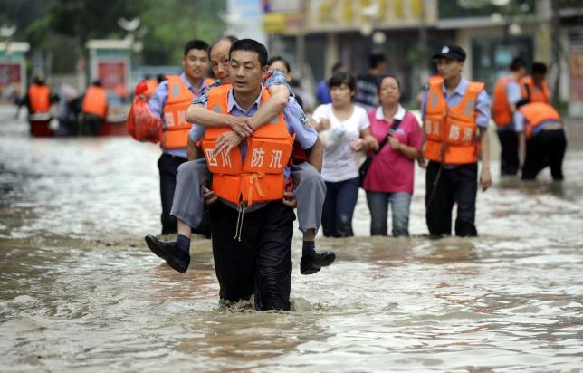 Қытайда 67 адам су тасқынының құрбаны болды